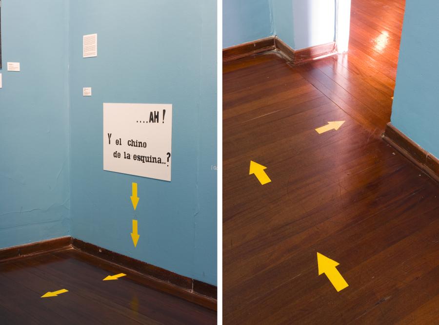 Luis Arias Vera, ¿Ah, y el chino de la esquina?, 1965 (Reconstrucción 2007). Cartel pintado con spray y líneas amarillas sobre pared y el suelo hacia el exterior de la galería. Foto: Miguel A. López