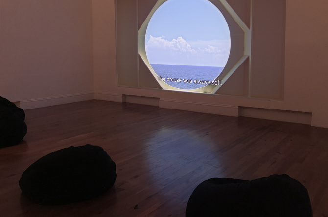 Joiri Minaya, Labadee, 2017, video HD, 7 min 10 seg. Vista de la instalación en la National Art Gallery of the Bahamas. Foto cortesía: NAGB