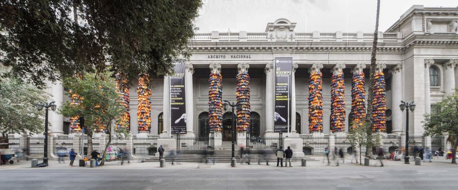 "View of the intervention ""Safe Passage"", by Ai Weiwei, in the columns of the facade of the National Archive of Chile, Santiago, 2018. Photo: Benjamín Matte"