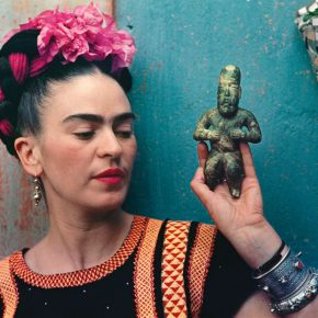 Frida Kahlo with Olmec figurine, 1939. © Nickolas Muray Photo Archives