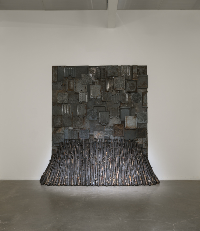 "Nari Ward, Iron Heavens, 1995, oven pans, ironed sterilized cotton, and burnt wooden bats, 140 x 148 x 48 in (355.6 x 375.9 x 121.9 cm). ""Nari Ward: We the People,"" 2019. Exhibition view: New Museum, New York. Photo: Maris Hutchinson / EPW Studio"
