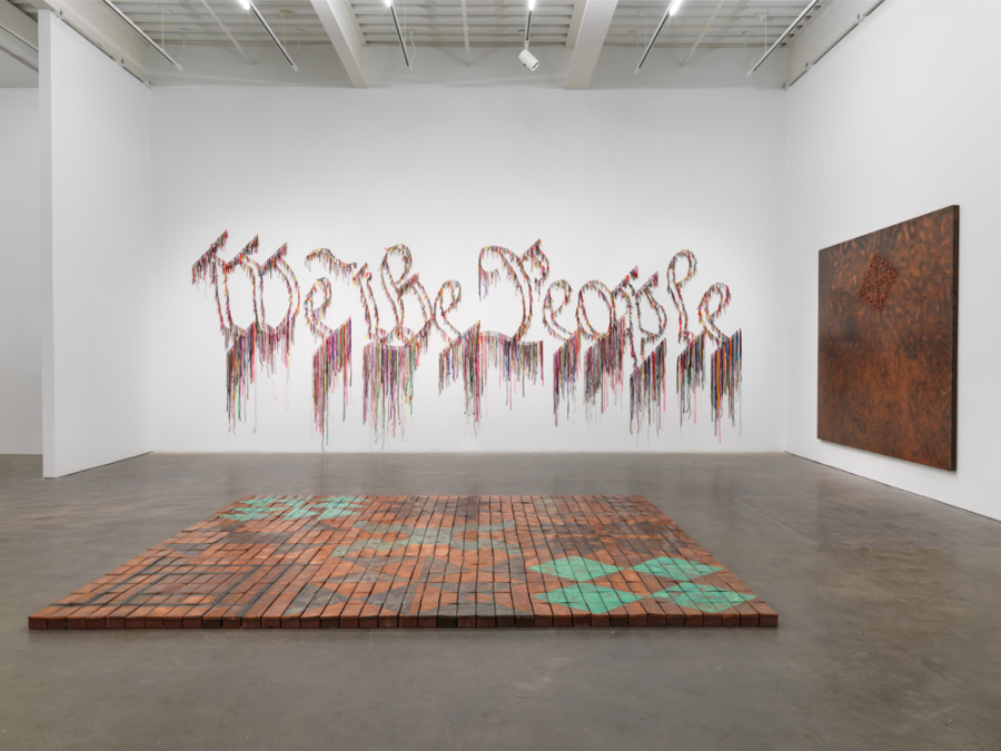 "Nari Ward, We the People, 2011, shoelaces, 96 x 324 in (243.8 x 594.4 cm). ""Nari Ward: We the People,"" 2019. Exhibition view: New Museum, New York. Photo: Maris Hutchinson / EPW Studio"