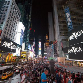 Midnight Moment: Alfredo Jaar, A Logo for America, August 1-31, 2014; 11:57-midnight, every night. Photograph by Ka-Man Tse for @TSqArts. Midnight Moment is a presentation of the Times Square Advertising Coalition (TSAC) and Times Square Arts. This month in in collaboration with the Solomon R. Guggenheim Museum. Midnight Moment: A Digital Gallery is the largest coordinated effort in history by the sign operators in Times Square to display synchronized, cutting-edge creative content at the same time every day.