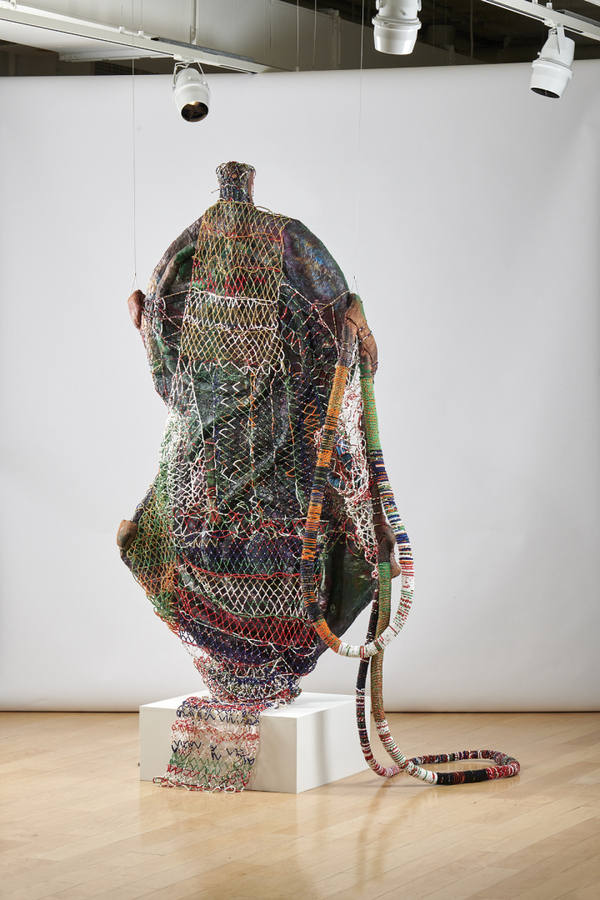 "Leonardo Benzant, ""The Tongue On The Blade: Serenade For Aponte And All Those Who Have Vision"" (2017), Chickenwire, paper mache, fabric, sawdust, coffee, sand, string, clay, acrylic gel medium, monofulmatnet, and glass seed beads. Courtesy Clair Oliver Gallery, New York. Photo: MoAD"