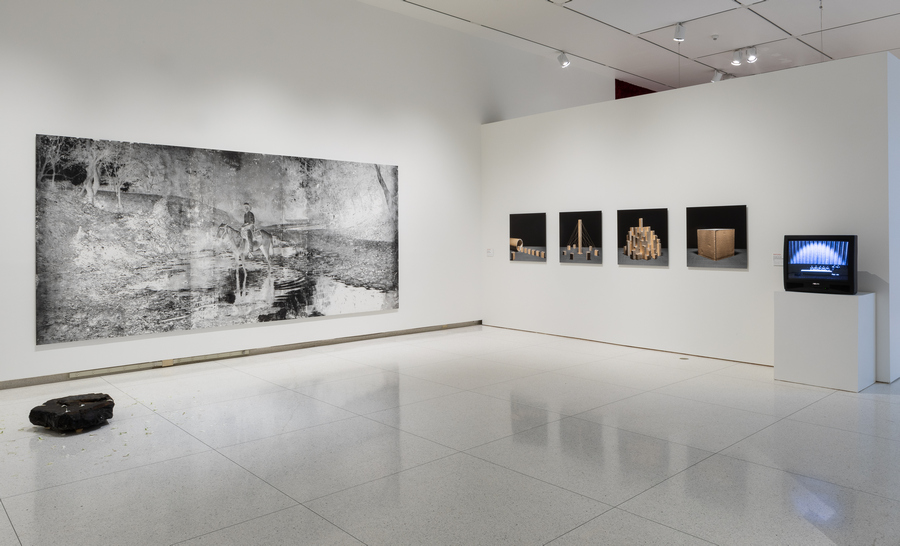 Left: Harold Mendez, Untitled (We are a thousand petals to no one), 2019, Obsidian, water, and carnation and alstroemeria petals. Harold Mendez, Sin Nombre, 2018, Cotton, graphite, gesso, watercolor, toner, litho crayon on ball grained aluminum lithographic plate mounted on Dibond. Courtesy of the artist and Patron Gallery. Right: Alejandro González, Pelos en la lengua, 2017, Archival pigment ink print photographs mounted to Sintra panels. Alejandro González, Uno p'alante y dos p'atrás, 2018, 16 mm black and white film stop-motion animation, digital transfer, 2:10 minutes. Courtesy of the artist.