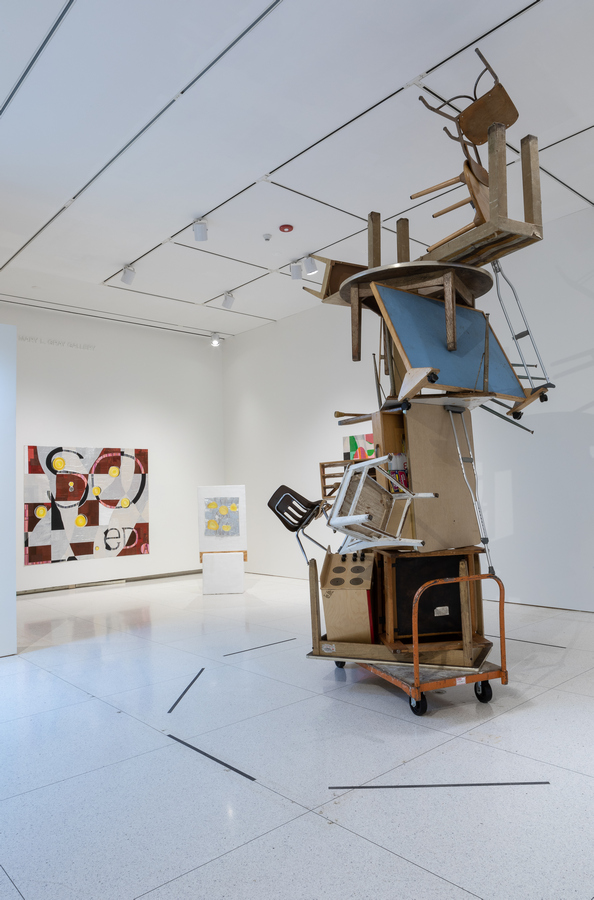 Foreground: Humberto Diaz, Failed Dream, 2019, Used furniture and objects. Courtesy of the artist. Background (left to right): Dianna Frid, Soledad, 2019, Canvas, paper, embroidery floss, aluminum and paint. Dianna Frid, From Before You Had a Name, 2017, Plaster, cardboard, cement, paint, wood, canvas, embroidery floss, metal, rocks and minerals.