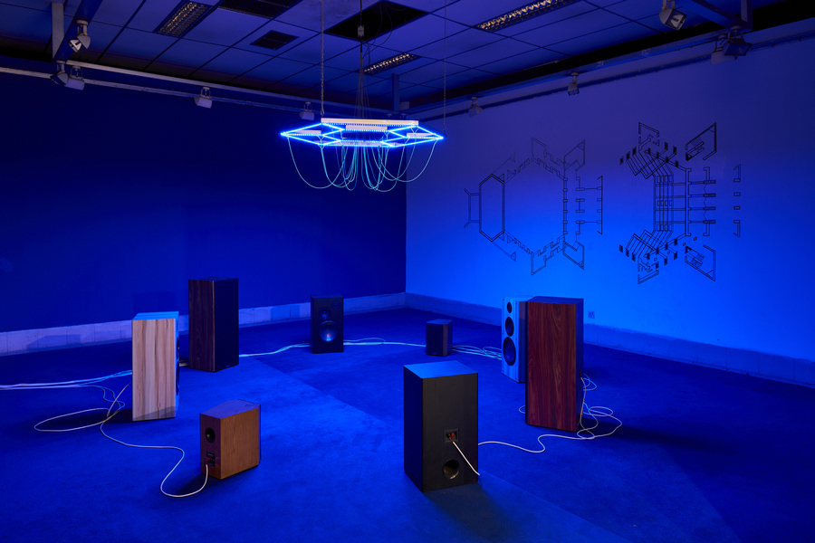 Haroon Mirza, 'Lectures in Theology', 2019-2020, 24-channel electrical signals for Hi-Fi speakers and LEDs, steel, electrical wire, bespoke media device, carpet, and wall painting. Commissioned and produced by Samdani Art Foundation and Lisson Gallery for DAS 2020. Courtesy of the artist, Samdani Art Foundation, and Lisson Gallery. Photo: Randhir Singh.