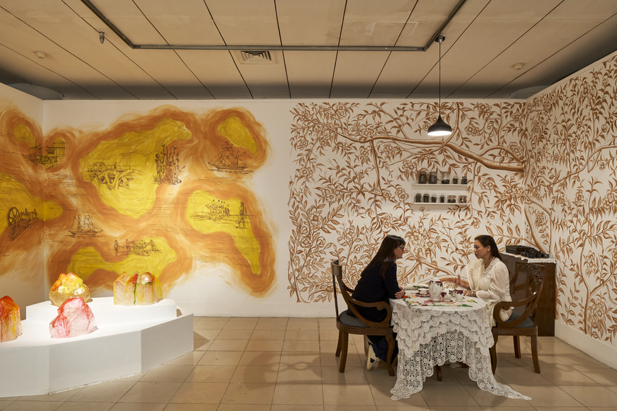 Installation view – Right: Yasmin Jahan Nupur, 'Let Me Get You a Nice Cup of Tea', 2019–20, antique furniture, antique tea set, embroidered textiles, tea, performance. Commissioned for DAS 2020. Courtesy of the artist and Exhibit320, with support from the Peabody Essex Museum, Salem. Left: Elia Nurvista, 'Sugar Zucker', 2016-2020, crystallised sugar, mural. Courtesy of the artist.